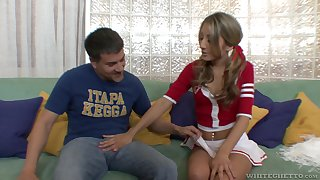Cute pigtailed cheerleader Natalia Rossi gives a blowjob and rides cock