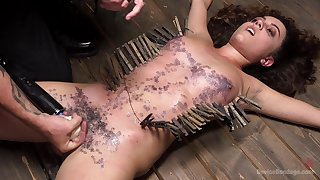 Teen babe gets covered in wax during a handsome harsh BDSM play