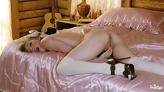 Teen pet Ivy Wolfe pleasures herself on a formerly larboard satin blanket